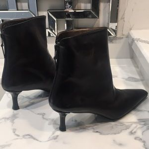 Stuart Weitzman pointy toe zip up ankle booties